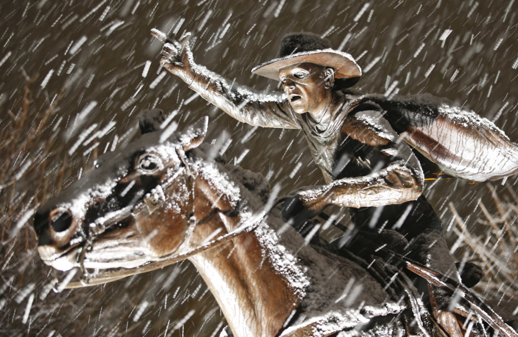 Snow lands on the statue of the Masked Rider on Friday, Jan. 8, 2015, at Texas Tech in Lubbock, Texas. (Brad Tollefson/A-J Media)